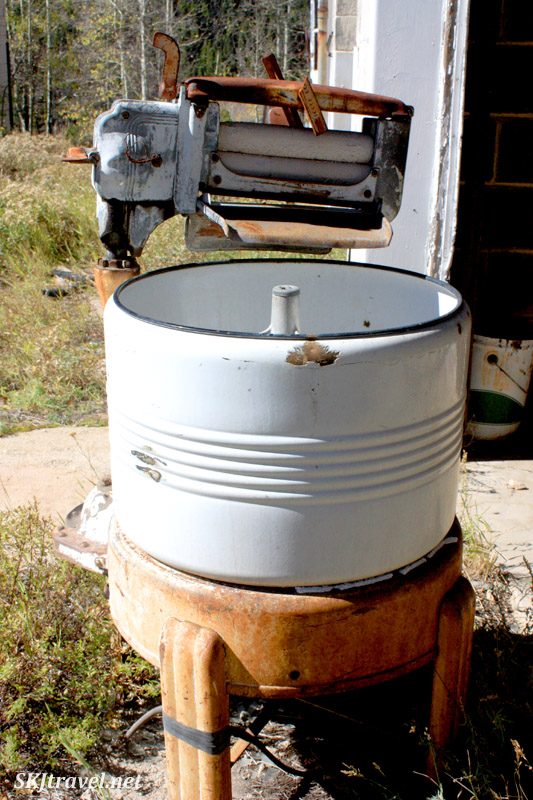 Old washing machine with wringing rollers, abandoned in Gilman, Colorado.