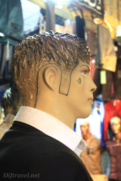 Painted side burns on a male mannequin in the bazaar in Isfahan, Iran.