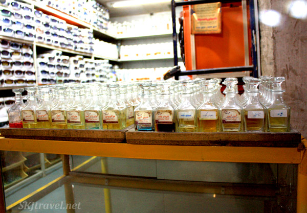 Row of glass bottles of different scents at a perfumery in the bazaar in Isfahan, Iran.