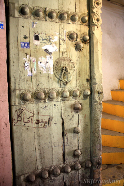 Old door leading to a winding stairway in a corridor inside the bazaar in Isfahan, Iran.