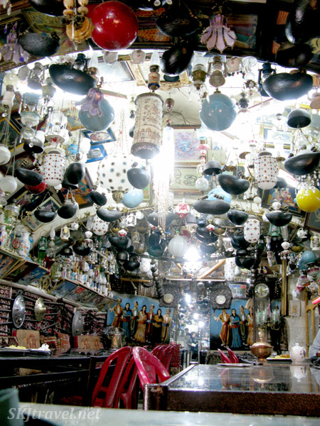 Gobs of lanterns and incense burners hanging from the ceiling of a traditional tea house in Isfahan, Iran.