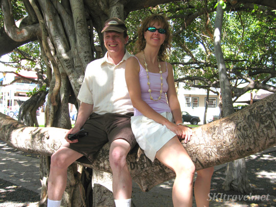 Erik and Shara sitting on the giant banyan tree in Lahaina, Maui, Hawaii.
