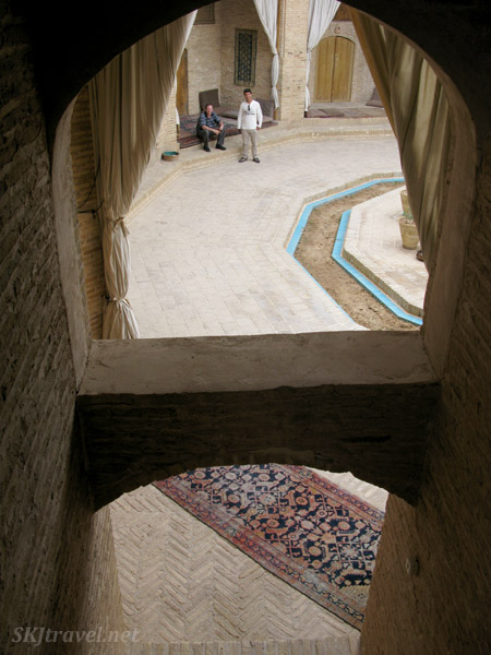 Looking down into the central courtyard in an old Old caravansary turned into a hotel and tea house along the road between Kerman and Yazd, Iran.