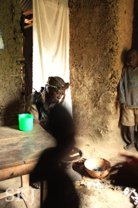Black shadows in the photo of the witch doctor in the lower Rwenzori Mountains, Uganda.