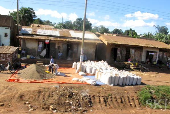 Sacks of charcoal for sale along the road, Uganda.
