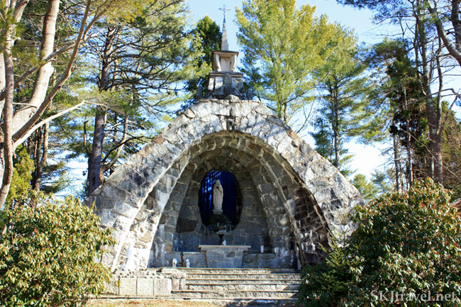 Man-built stone grotto with Virgin Mary statue on the grounds of Lithuanian Monastery, Maine. Photo by Shara Johnson