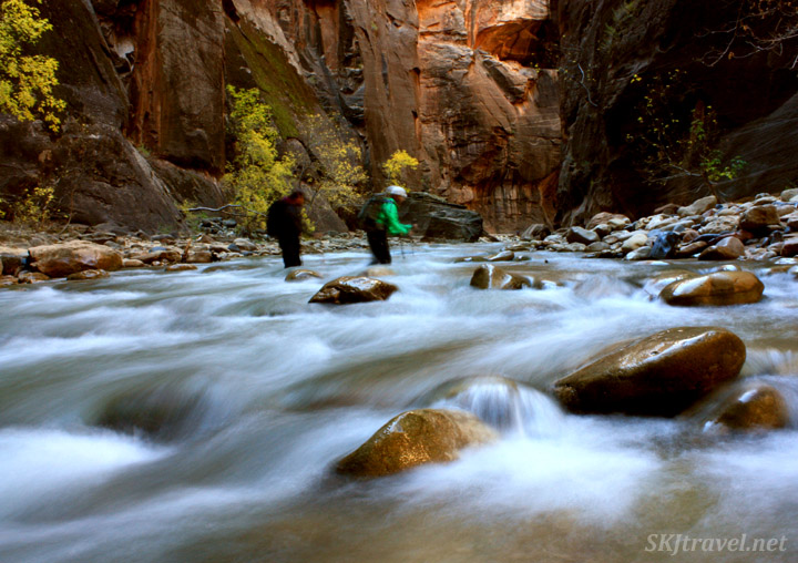 Crossing the Virgin River in The Narrows; walking sticks essential.