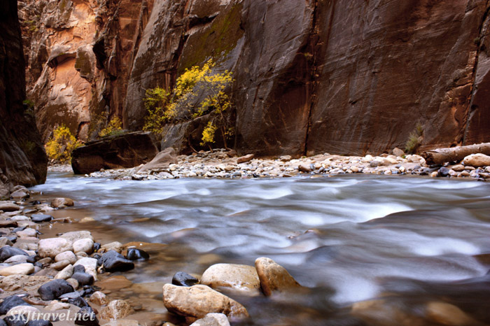 Smooth shallow flowing river in narrow canyon.