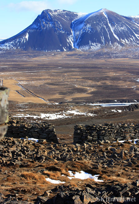 Looking over remains of medieval stone walls into a wide valley, Iceland. Photo by Shara Johnson