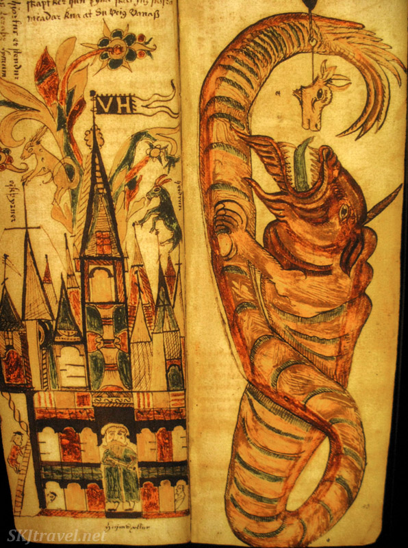 A dragon beast about to feed. Page from a medieval Icelandic saga manuscript, in the Culture House, Reykjavik, Iceland.