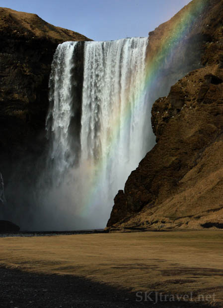 Beautiful Skogafoss with a rainbow in the mist. Iceland.
