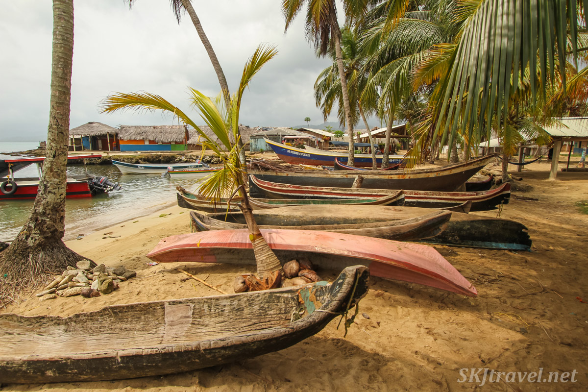 Dugout canoes lined up on the beach of Anachakuna, Guna Yala, Panama.