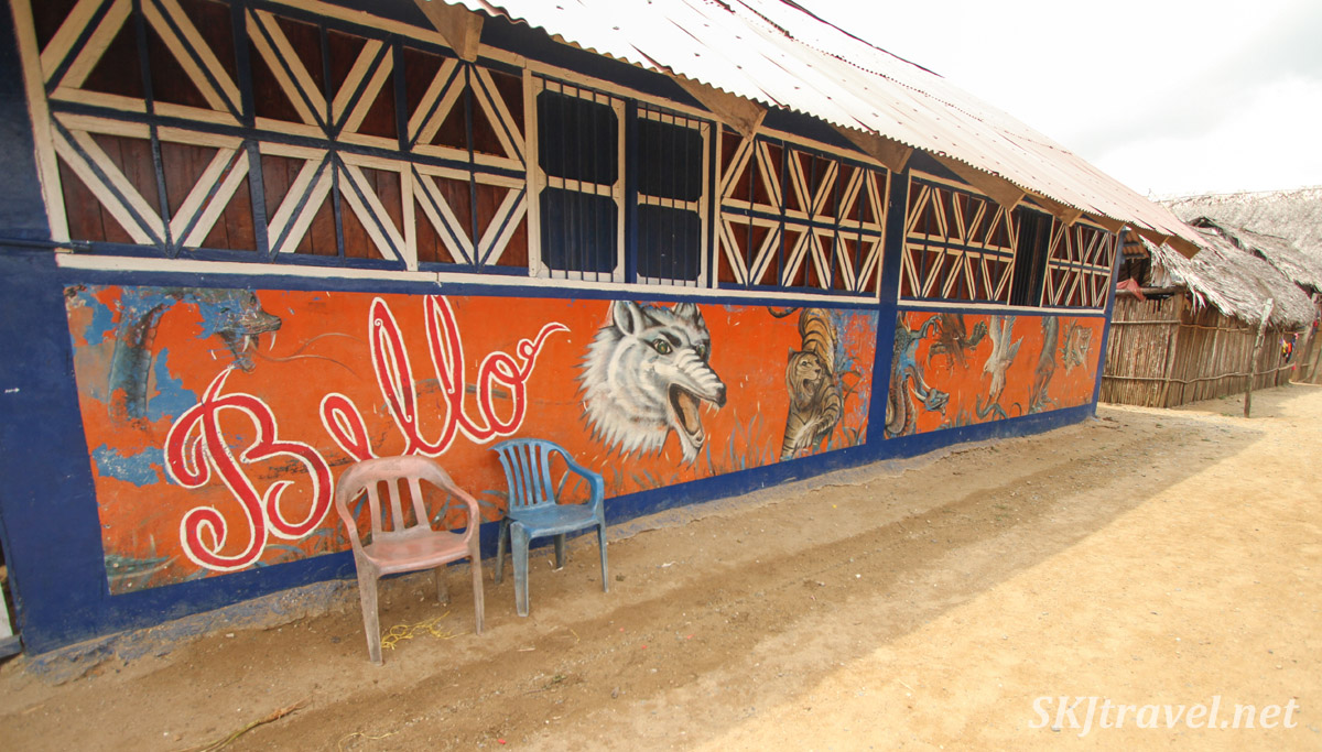 Wooden community building, painted with murals. Anachakuna, Guna Yala, Panama.