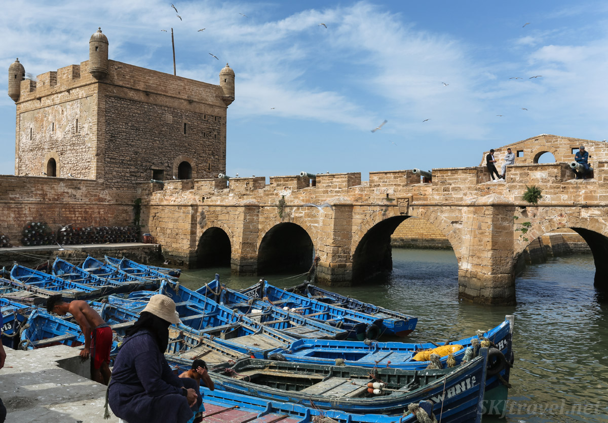 Blue boats by the tower and bridge, Essaouira, Morroco.