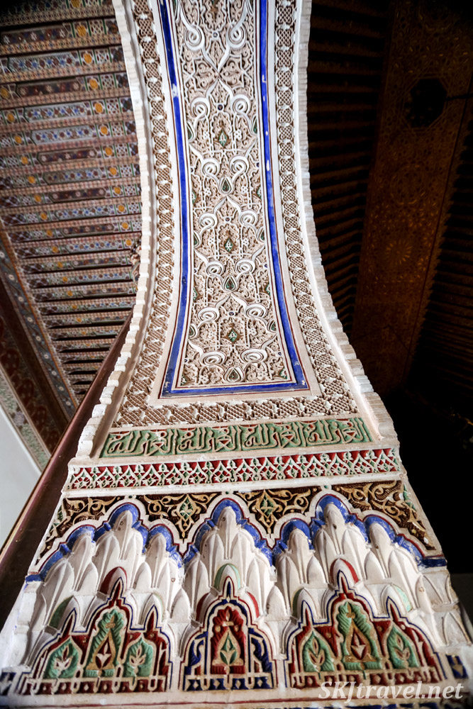 Cedarwood painted ceiling with detailed Moroccan carved stucco in archway. Bahia Palace, Marrakech, Morocco. UNESCO World Heritage.