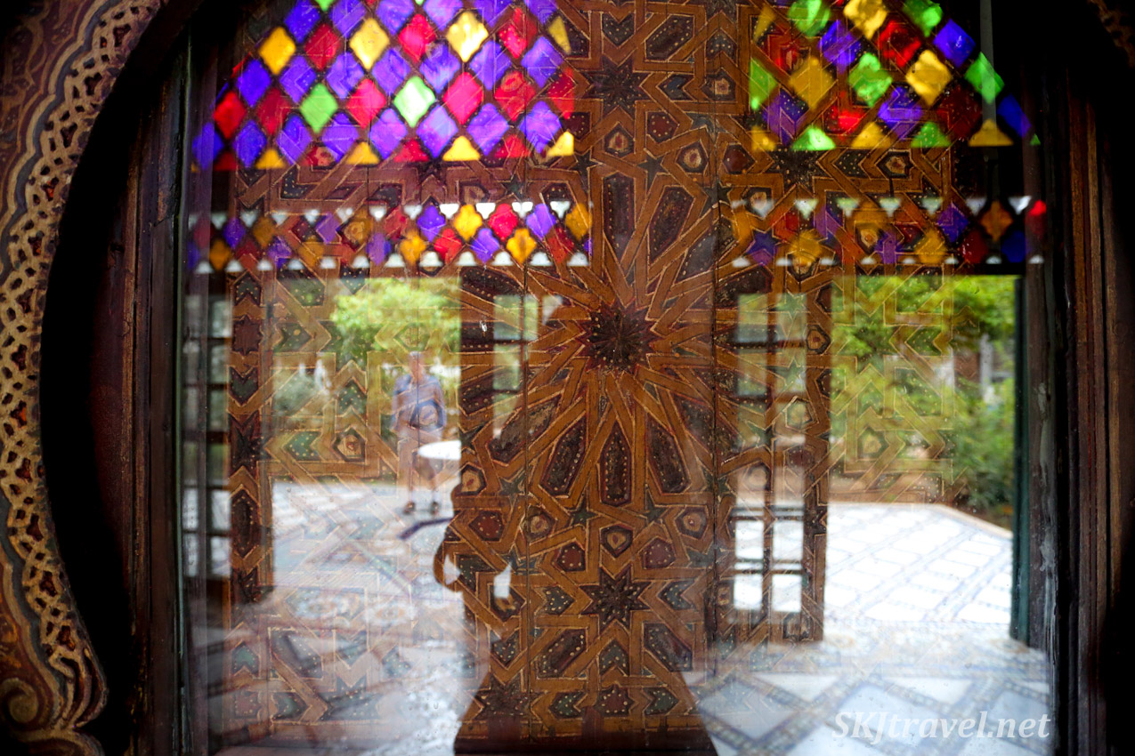 Reflection of open doors and stained glass. Bahia Palace, Marrakech, Morocco. UNESCO World Heritage.