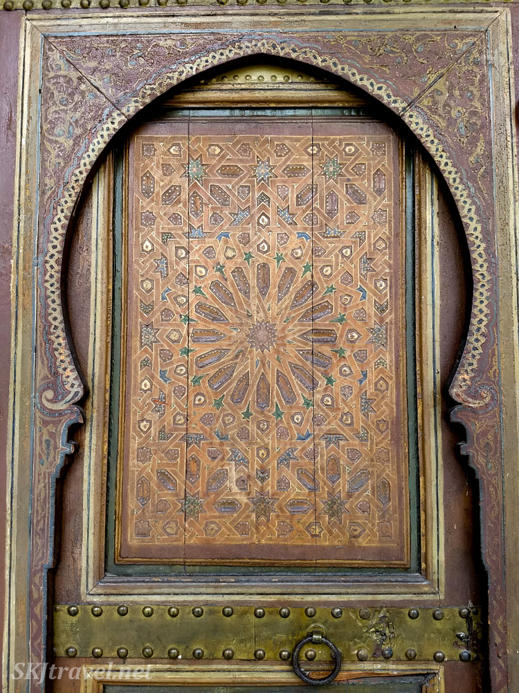Painted wooden door. Bahia Palace, Marrakech, Morocco. UNESCO World Heritage.