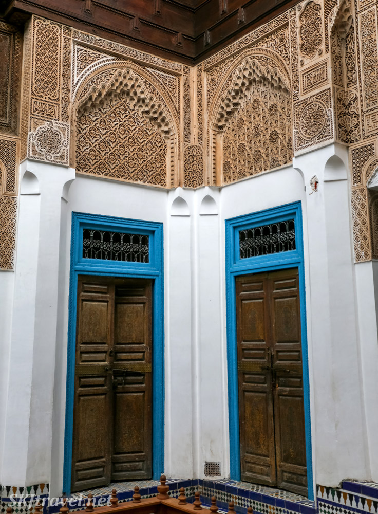 Wooden doors and Moroccan carved stucco above. Bahia Palace, Marrakech, Morocco. UNESCO World Heritage.
