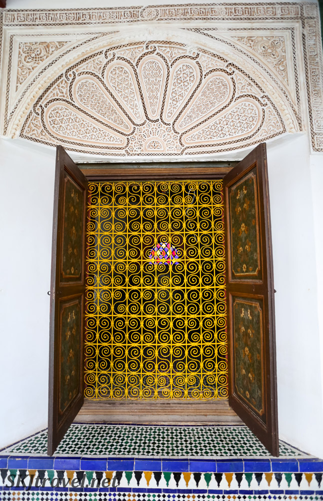 Bahia Palace, Marrakech, metal grate across doorway, stained glass, carved stucco and tilework. UNESCO World Heritage.