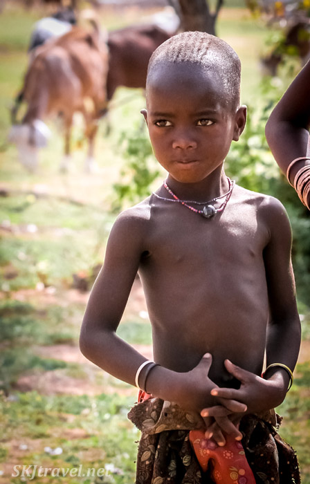 Intense gaze of a Himba child, northern Namibia.