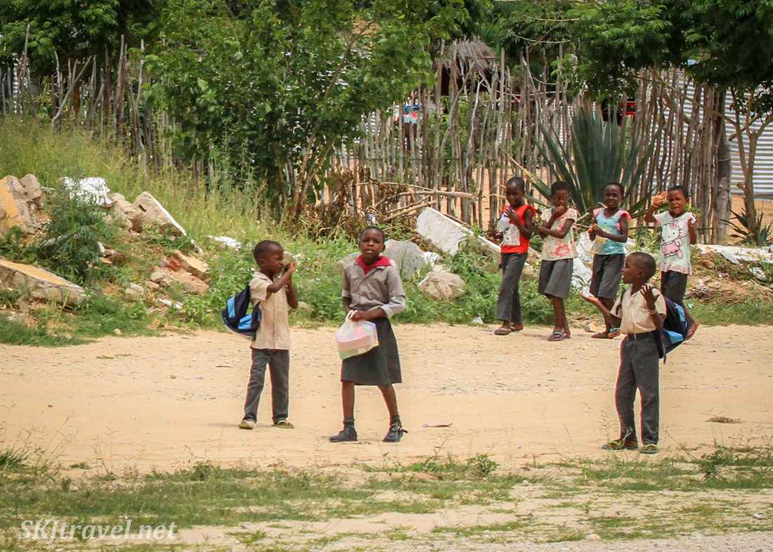 Children walking home from school along the road, northern Namibia.