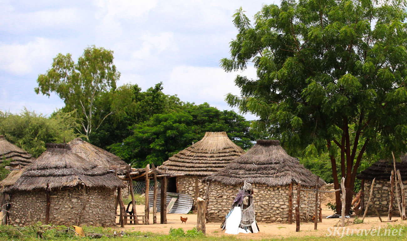 Traditional home of stone and thatched roof, northern Namibia.