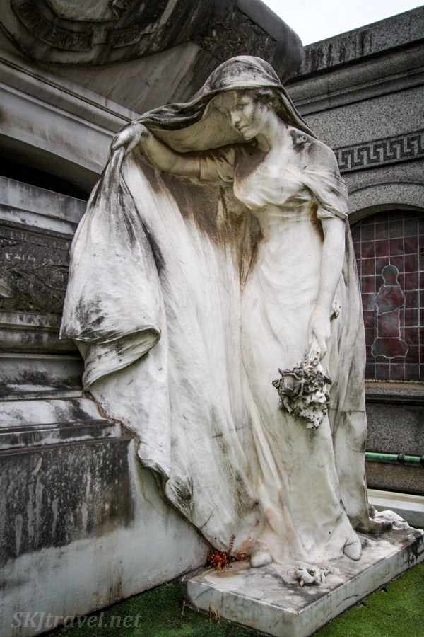Life size stone statue in Recoleta Cemetery, Buenos Aires, Argentina.