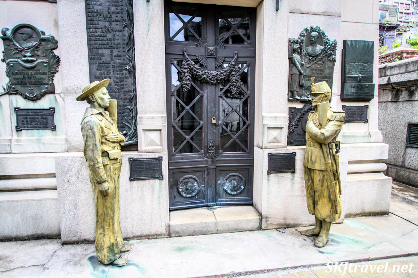 Bronze statues outside a large mausoleum in Recoleta Cemetery, Buenos Aires, Argentina.
