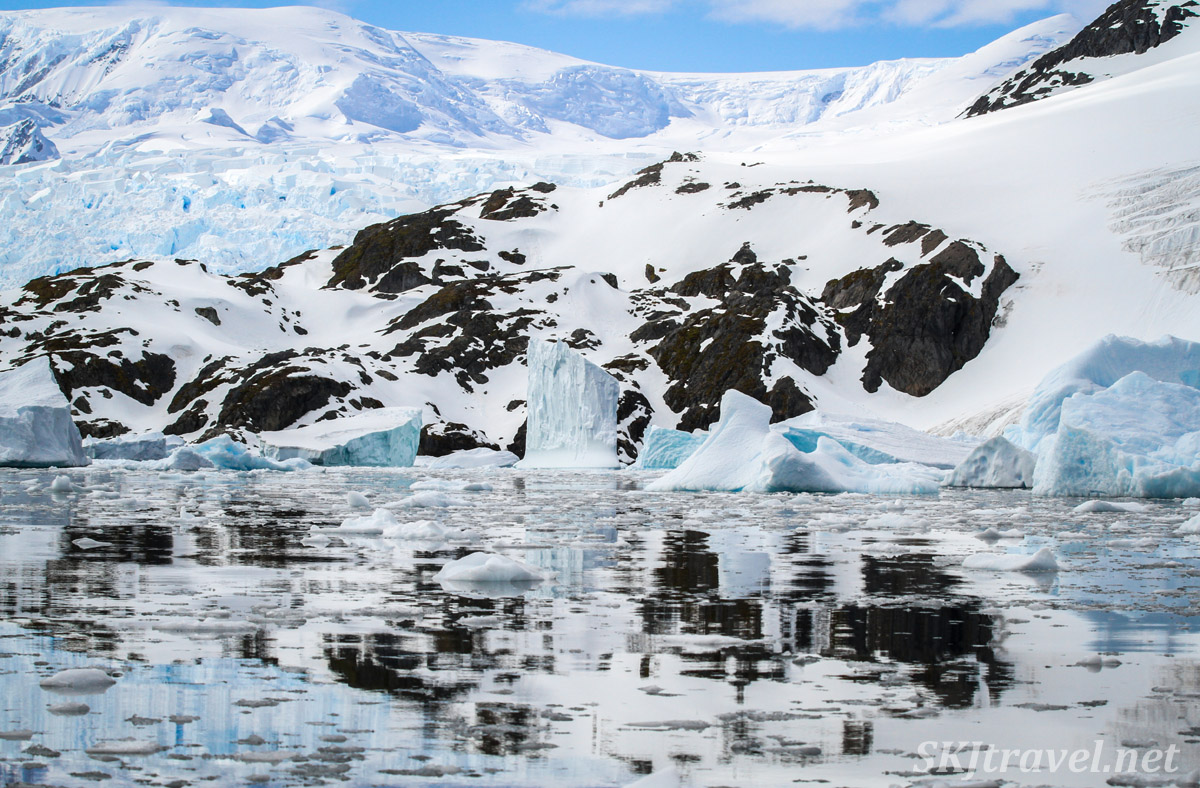 Chaotic reflection of land, snow and sky in Cierva Cove, Antarctica.