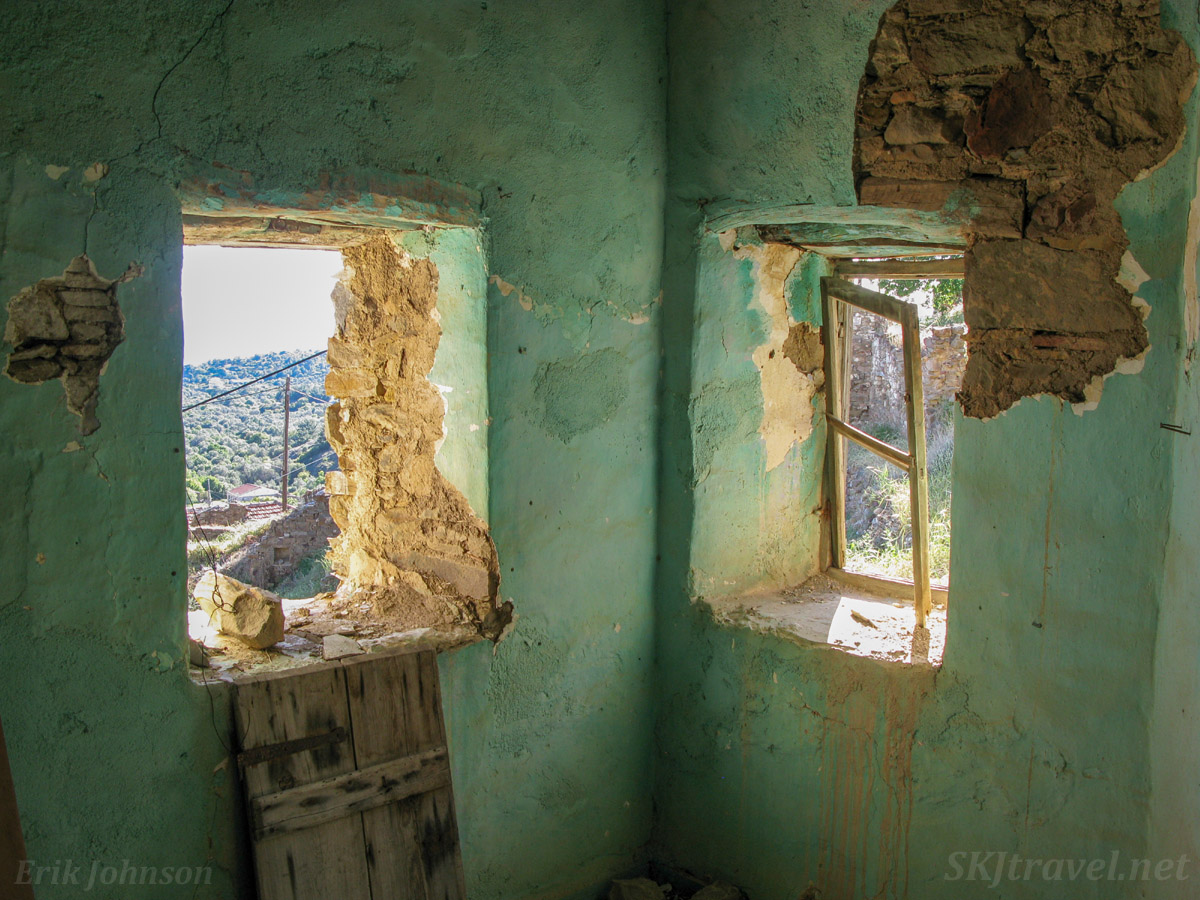 Looking out the windows of an abandoned home in Volissos, Chios Island, Greece.