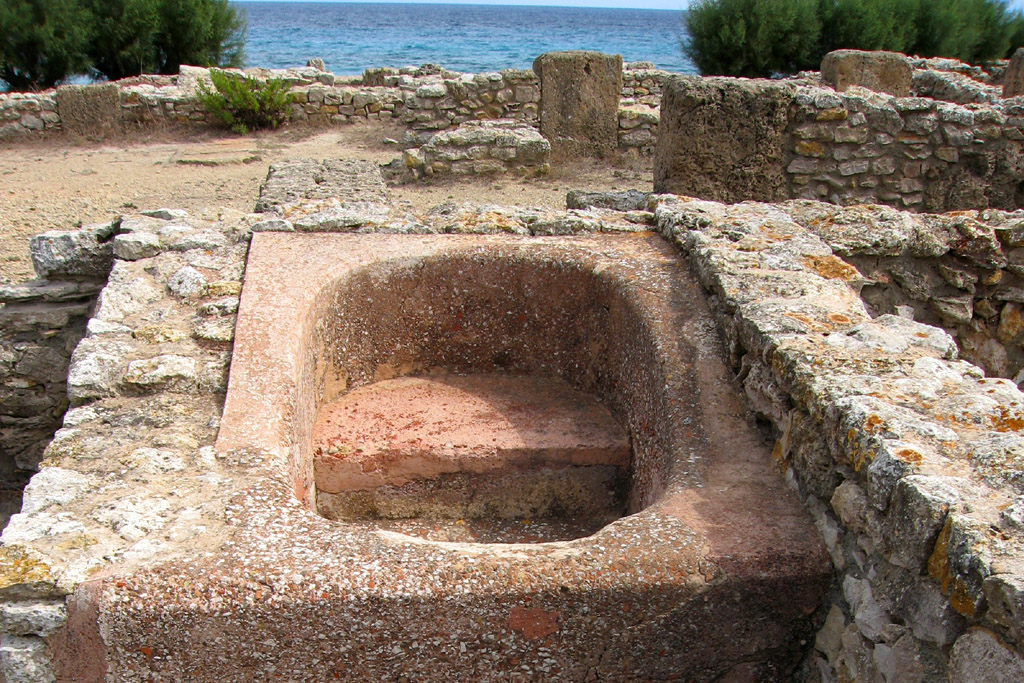 Ancient stone bath in the ruins of the Punic city of Kerkouane, Tunisia.