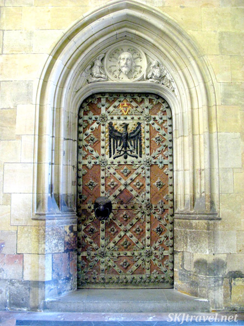 I think it's a rather spectacular door but seems somehow almost out of place inside a cathedral. Where does it lead to? Prague.