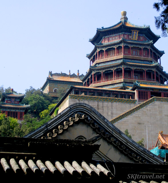 Layers and pagodas and buildings flow back into the woods. Summer Palace, China.