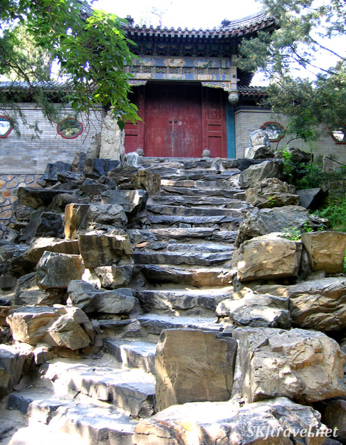 Stone steps up to a red door in a wall with little portals ... this seemed really magical to me. Summer Palace, China.