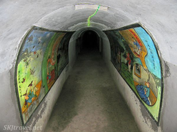 Tunnels lined with paintings in the tunnels of Hell beneath Gao Miao temple, Zhongwei, China.