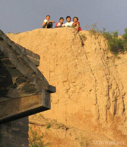 Children lined up on the hillside above the loo outside my courtyard in rural village of Dang Jiashan, northern Shaanxi province, China.