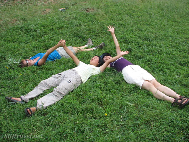 Me, Cao-Yu and Li-Li lying in a grassy meadow in Dang Jiashan Valley, Shaanxi Province, China.