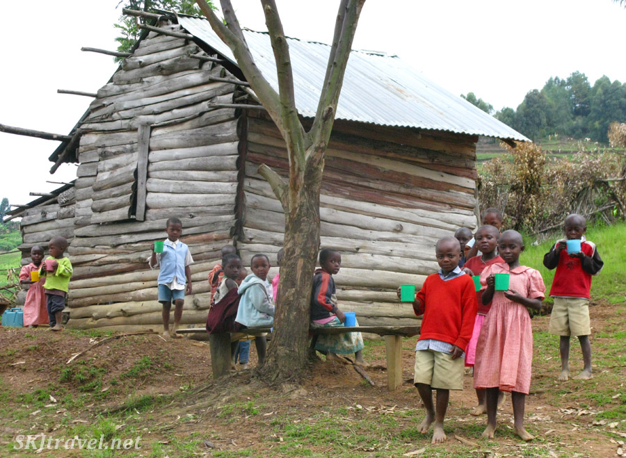 Children eating porridge outside a make-shift primary school at Lake Bunyoni, Uganda.