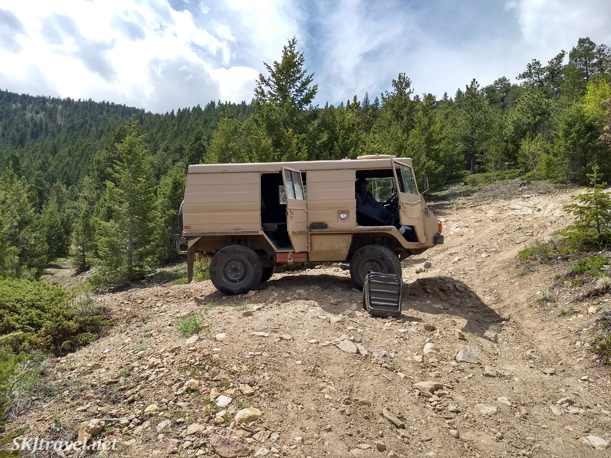 Pinzgauer 710K (front seat removed to access the engine) below the Switzerland Trail, near Nederland, Colorado.
