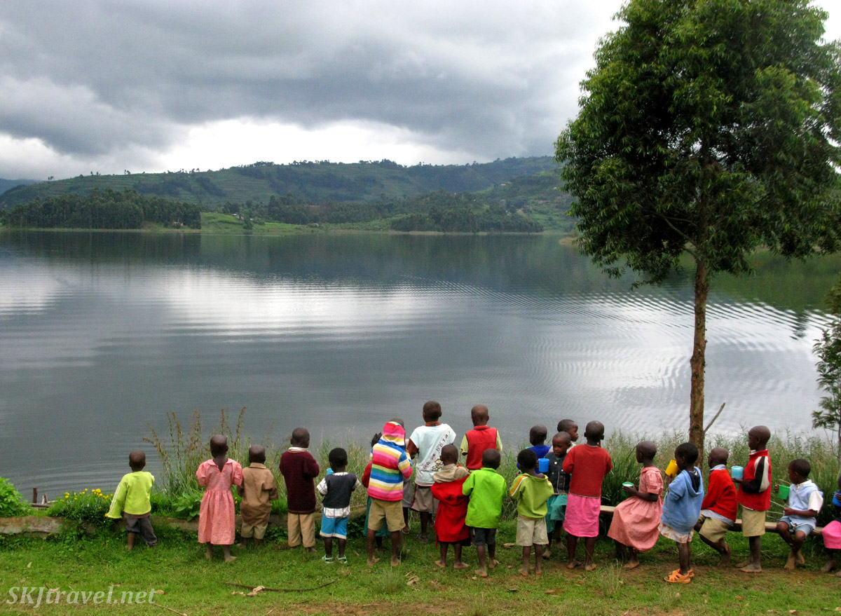 Primary school children looking out over Lake Bunyoni, Uganda.