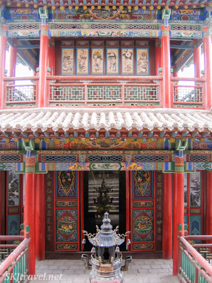 So much elaborate paining on doors and eaves ... incense burners stand before many of the doorways. Gao Miao, Zhongwei, China.