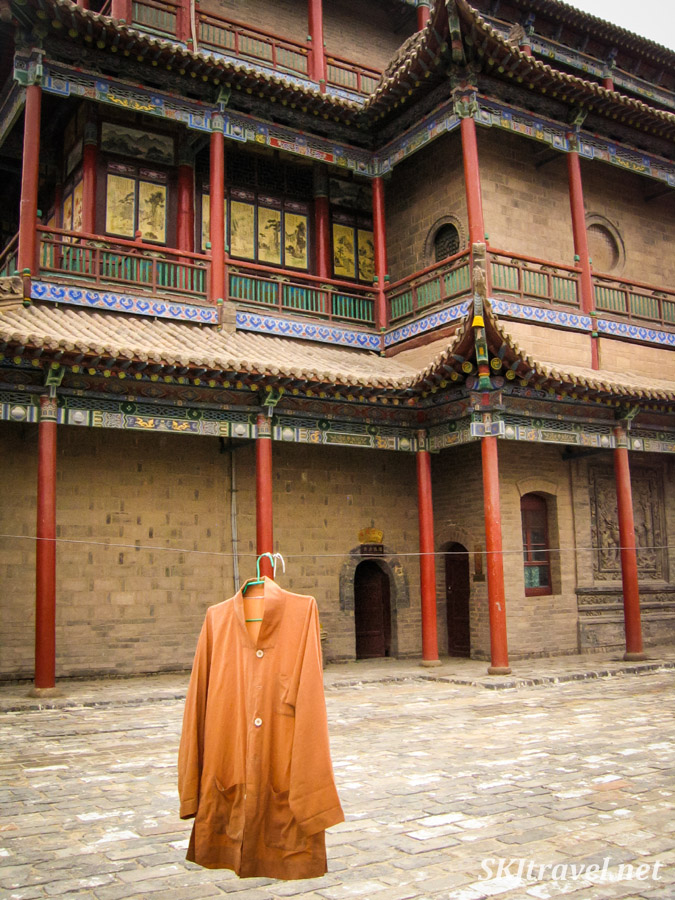 Monk's shirt hanging to dry on a clothesline in a courtyard of Gao Miao, Zhongwei, Ningxia Province, China.