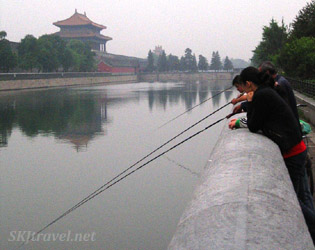 Beijing citizens fishing in the moat outside the Forbidden City.
