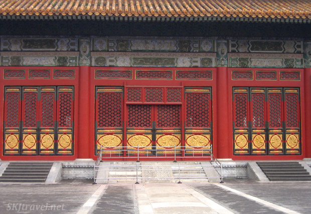 Very tall doors on a large building in the Outer Courtyard of the Forbidden City. Beijing.