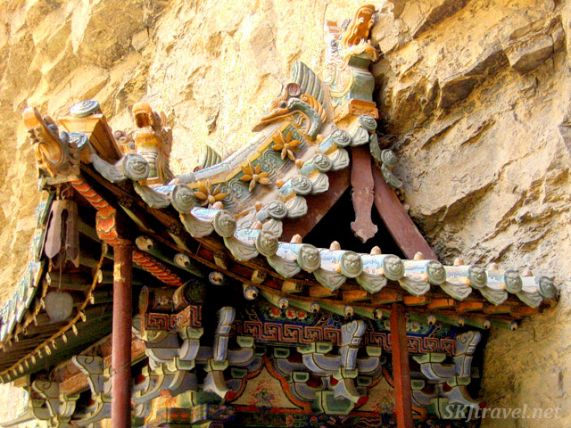 Detail of the roof of a shrine hugging the cliff face at the Hanging Monastery, Datong, China.