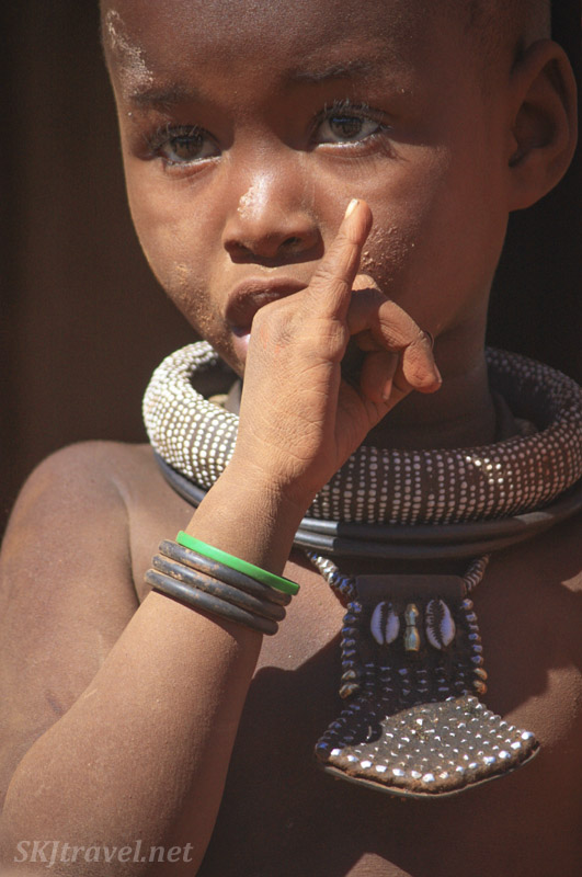 Himba toddler sucking her thumb. Kaokoland, Namibia.