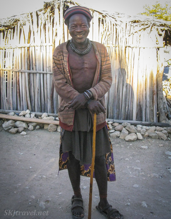 Friendly older Himba man in a non-traditional village near Epupa Falls, Kaokoland, Namibia.
