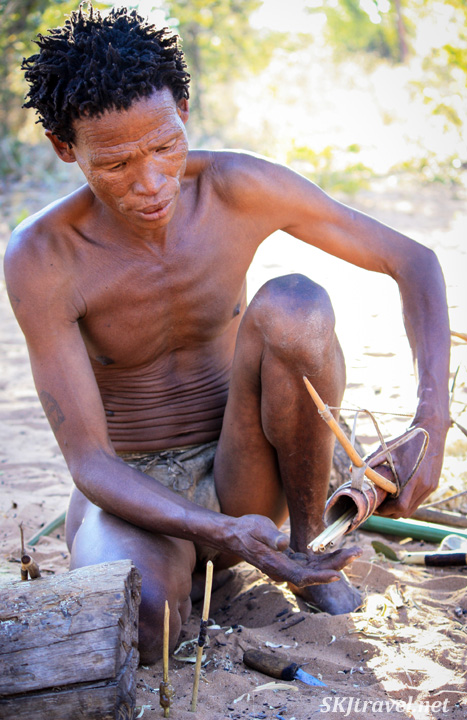 San man with a quiver of arrows at the Ju/'Hoansi-San Living Museum near Grashoek, Namibia.