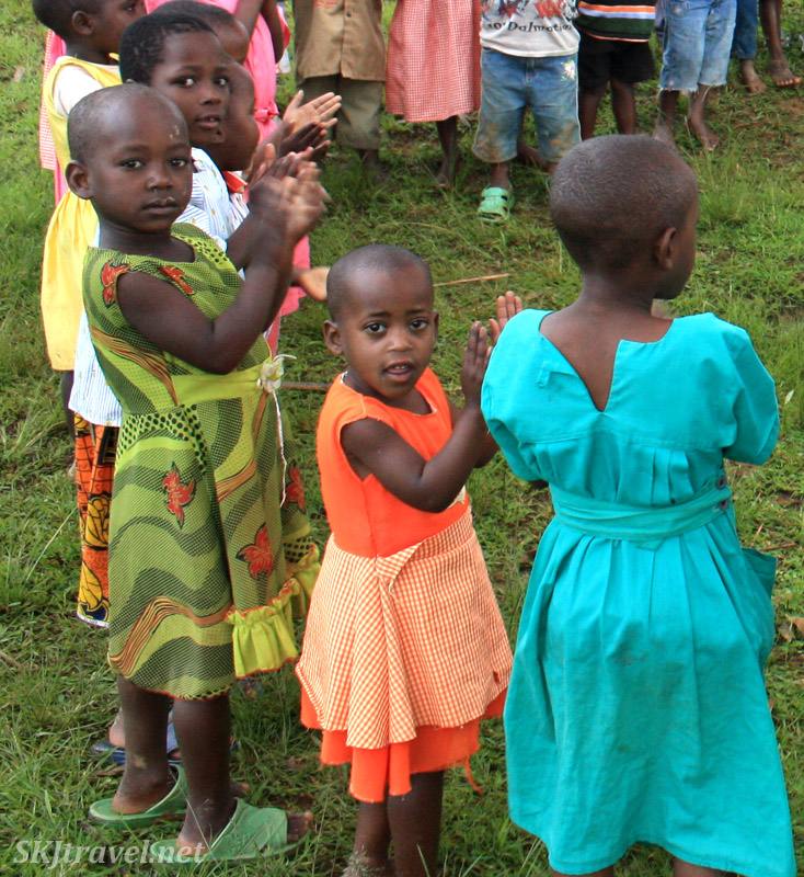 Little girl singing songs with classmates at primary school, Lake Bunyoni, Uganda.