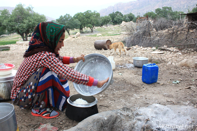 The daughter making rice for dinner at the Qashqai camp outside Shiraz, Iran.